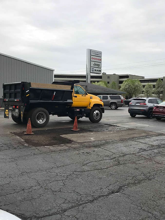 Patching the asphalt at a car dealership in South Bend.